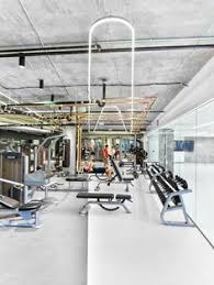 dropbox office san francisco. a custom walnut table stretches 40 feet through the library at dropbox headquarters rapt office san francisco