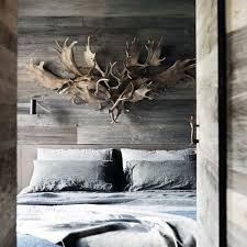 mens bedroom themes with antler decor on wood walls