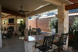 Fort Worth Covered Patio with Pergola Outdoor Kitchen and Outdoor Fireplace  traditional-veranda