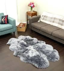 silver sheepskin rug grey sheepskin rug grey quad sheepskin rug 4 joined pelts a larger photo silver sheepskin rug