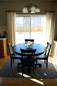 good kitchen design and how to place a rug with a round dining table area rug