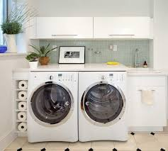 Trendy laundry room photo in New York with a drop-in sink, flat-