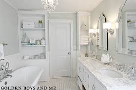 elegant master bath remodel with built in shelving featured on remodelaholic com