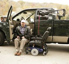 wheelchair lift for car. Man Sitting In Truck With Wheelchair Lift For Car R
