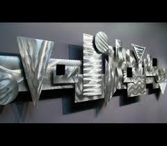 the complex arrangement of small elements in this abstract metal wall art sculpture rectangles squares triangles  on abstract metal wall art sculpture with wall art collection idea metal wall art sculptures custom metal