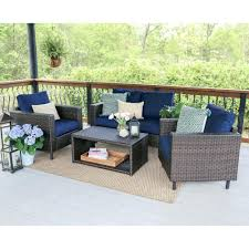 leisure made dr 4 piece wicker outdoor conversation set with navy cushions