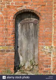 overwhelming old doorway an old rotting wooden door in an arched doorway in a very old