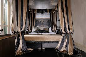 Luxury Bedroom Curtains A King Bed With Striped Taffeta Curtains Bishop Sleeved Up At The