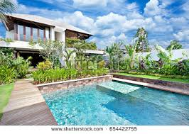 luxury home swimming pools. Modern Blue Water Swimming Pool In A Luxury House With Fancy Garden Around It Home Pools