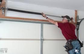 slide torsion springs to center above garage door