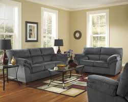Next Living Room Furniture Single Wide Gray Sofa With Pillows On Top Next To Bare Tree On
