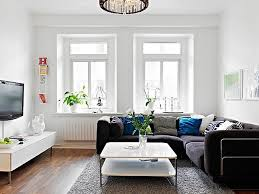 Scandinavian Narrow Living Room Ideas With L Shaped Black Sofa And White  Coffee Table
