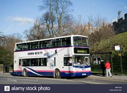 double decker first bus in city centre manchester stock photo double decker bus in first livery waiting at a bus stop in a city centre in