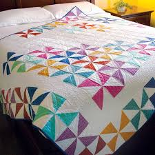28 best images about Decorate with Quilts on Pinterest | Quilt ... & SPRING SPIN Bright pinwheels lap quilt pattern Designed by BEV GETSCHEL  Machine quilted by CINDY MESERVEY Adamdwight.com