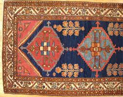 hand knotted antique persian hamadan oriental rug in small runner size with minimal