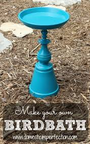 i made my birdbath out of a terracotta pot saucer and an old brass lamp but you can really use anything go crazy the motto here is if you can glue it