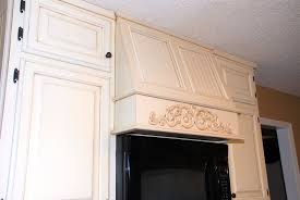 oak cabinets painted whiteRemodelaholic  From Oak Kitchen Cabinets to Painted White Cabinets