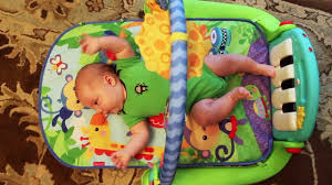 cute baby playing with the fisher kick play piano gym