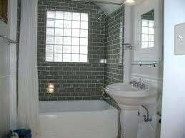 small bathroom remodel grey dark grey and white combine wall subway tile bathroom ideas with white bathtub and white sink with glass block window wall mount