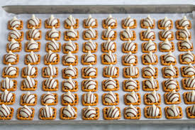 adding hugs to pretzels on baking sheet