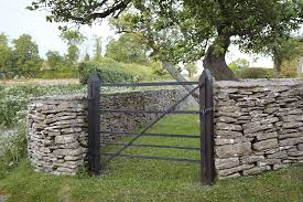 because there is no mortar used dry stone walls are flexible if ground moves