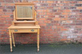 A small pine dressing table, with rectangular mirror over a drawer, on  turned legs, with a simila