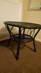 dark grey round side cane coffee table