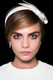 from the bushy eyebrows to the orange eye shadows to the full lashes this beauty look is very 60s