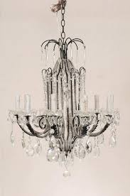 an italian ten light crystal and wrought iron chandelier this italian mid 20th