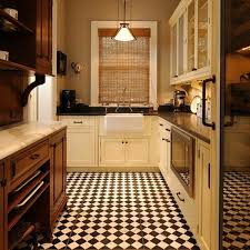 small checkerboard tiles are a good choice in a traditional kitchen design