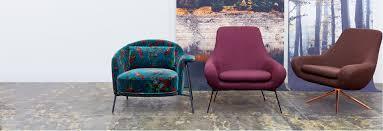 two modern architecturally shaped chairs facing forward in front of a glacial landscape inspired backdrop