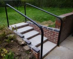 a garden more accessable originally 2 very steep steps now 5 easy rise steps with plenty of foot e and hand rails made especially for the job
