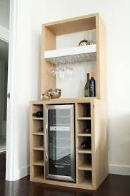 White Oak Bar with built in wine cooler and by DorothyMacikDesign