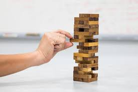 Game Played With Wooden Blocks Closeup Of Hand Playing Wood Blocks Stack Game Stock Photo Image 33