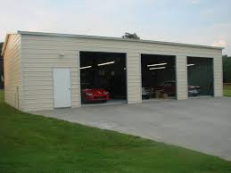 CAR GARAGE 24 X 50 X 12 WITH THREE 10 X 10 ROLL UP DOORS and