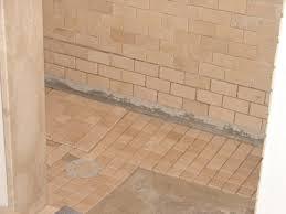 h art exhibition do you tile a bathroom wall or floor first