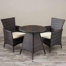 melissa multi brown 3 piece wicker round outdoor bistro set with creme cushions
