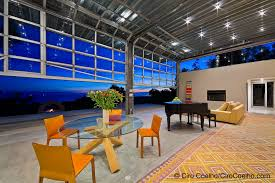 glass roll up doors merge your indoor outdoor space overhead sectional garage doors arm r lite