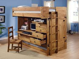 solid wood full size loft bed with desk and compact storage unit design also trundle on
