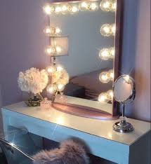 white flower with beautiful vanity mirror with lights for