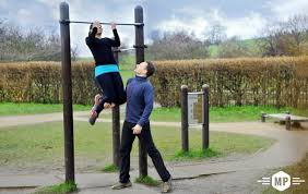 outdoor fitness chin up bar demonstration at trim trail