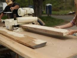 Run planks though the planer, stripping a small amount of wood from each  side as