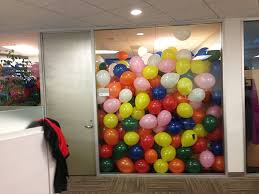 office conference room filled with balloons