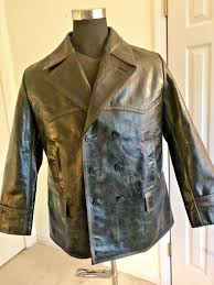 this is made from cowhide with a beautiful grain solid it has been tastefully pre distressed it even smells wonderful please note the measurements
