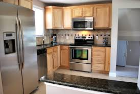 Light Maple Cabinets Pair Well With Dark Granite Countertops And