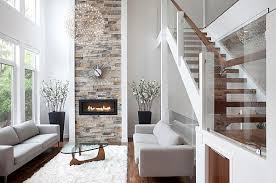 View in gallery Modern fireplace with sunburst clock overhead