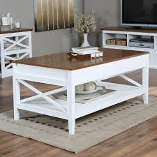 white wooden coffee table with crossed side and shelf combined with brown wooden counter top placed
