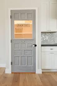 antique door repurposed as a pantry door by rafterhouse phoenix az