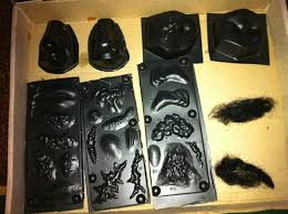 various molds for your nose eyes and ears as well as burns scars etc fake hair also part of the make up kit