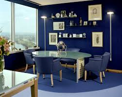 chic blue living room decorating ideas with dark blue wall paint